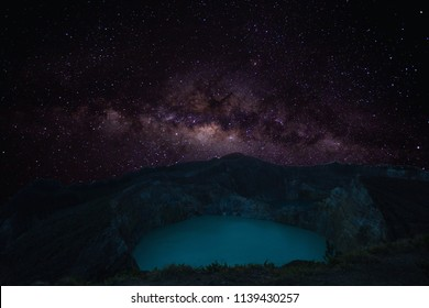 View of Mount Kelimutu and beautiful milky way with Tiwu Ko'o Fai Nuwa Muri and Tiwu Ata Polo  from small town of Moni, Ende, Flores Island, Indonesia.
