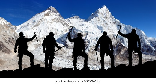 View of mount Lhotse from Pumo Ri base camp and silhouette of group of climbers with ice axe in hand, Everest area Khumbu valley, Sagarmatha national park, Nepal