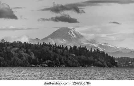 A view of Mount Rainier across the Puget Sound. Black and white image.