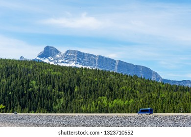 View of Mount Rundle and pine and aspen forest with motorhome on the road , Adventure trip , Road trip, Alberta, Canada