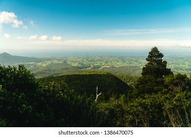 View from Mount Taranaki trek tramping trail. Green landscape, blue sky.Perspective view from the Pouakai Hut. Shot in North Island, New Zealand.