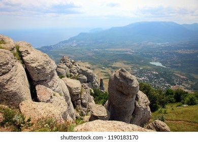 View from mount to valley in Dimerdjy place in Crimea, some stone giants in front