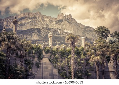 View of mountain Ai-Petri from the Vorontsov Palace in Crimea, Russia. Vorontsov Palace is one of the best-known sights of Crimea. Old architecture and nature of South coast of Crimea. Vintage photo.