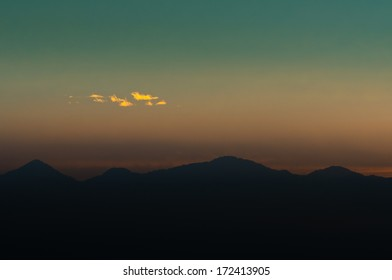 view of mountain with clouds