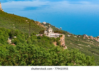 view from the mountain to the Foroskaya church on the background of the blue sea, a clear sunny day, Crimea Ukraine