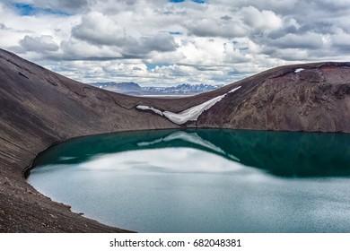 View of mountain lake Blahylur on mountains background Iceland