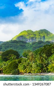 View of the mountain landscape in the lagoon Huahine, French Polynesia. Vertical
