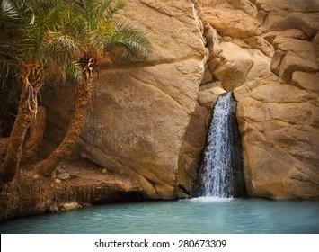 View of mountain oasis Chebika with waterfall, Sahara desert, Tunisia, Africa