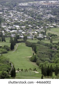 View from mountain on Oahu: fairway of golf course and town of Kaneohe beyond