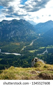 View from a mountain peak in a valley with a winding river near Oberammergau, Bavaria