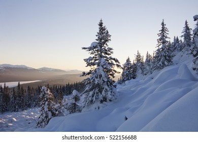 View mountain range Zyuratkul, winter sunset landscape. Snow covered spruces