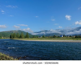 View of mountain river. Beautiful summer mountains landscape with clouds