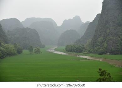 View from mountain and sampan tour in Tam Coc, Ninh Binh, Vietnam