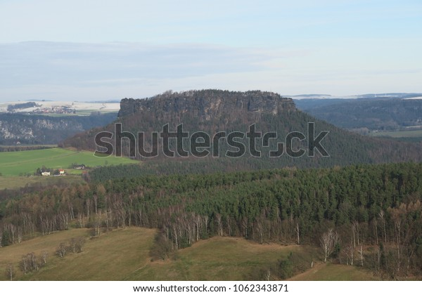 a view to a mountain in the saxon switzerland