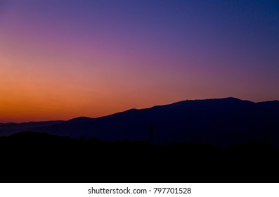 view of mountain silhouette on twilight sky after sunset
