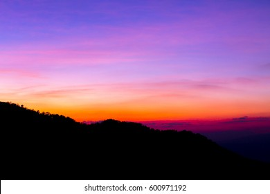 view of mountain siluate on twilight sky after sunset