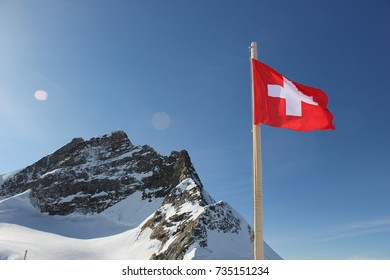 View of mountain and Swiss flag on top of Jungfrau, Switzerland