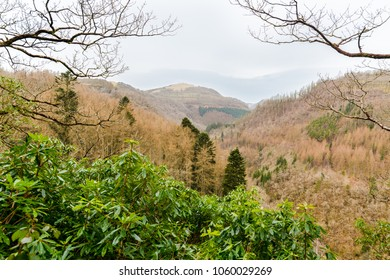 The view from a mountain top in Wales. A waterfall can be seen in the distance.