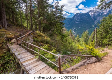 View at Mountain Trail in British Columbia, Canada. Mountains Background.