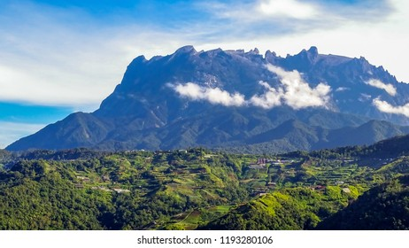 View at a mountain valley of the majestic mount Kinabalu with blue sky background at Ranau,Borneo,Malaysia.Nature view of Borneo tropical jungle.