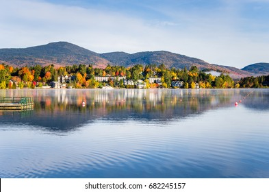 View of the Mountain Village of Lake Placid from a Foggy Mirror Lake at Sunrise - Shutterstock ID 682245157