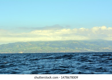 View of the Mountains Around Sete Cidades Obscured In Clouds from A Boat