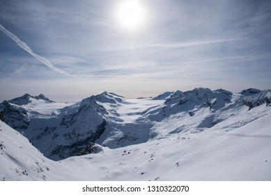 View of the mountains around the Tonale Pass from the Paradiso lodge during a winter sunny day. Tonale is a mountain pass between Lombardy and Trentino, near the Presena glacier