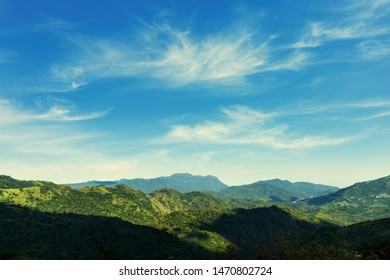 view of mountains with blue sky background