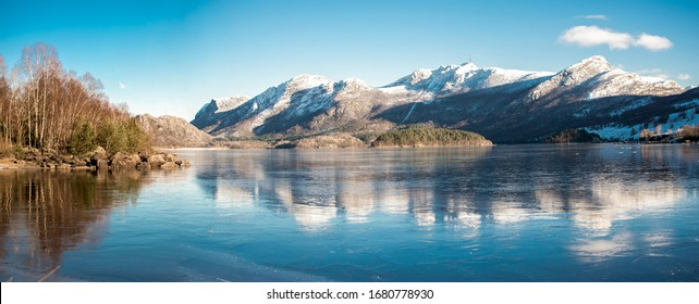 A view of mountains covered by snow at Oltedalsvatnet lake during winter season, Gjesdal commune, Norway, February 2018