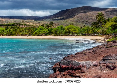A view of the mountains of the island of Lanai, Hawaii and a secluded public beach as viewed from Flat Rock.