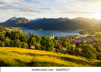 View of mountains and mountain lake during sunset in summer. Beautiful town of Schliersee in Bavaria, Germany, Europe.