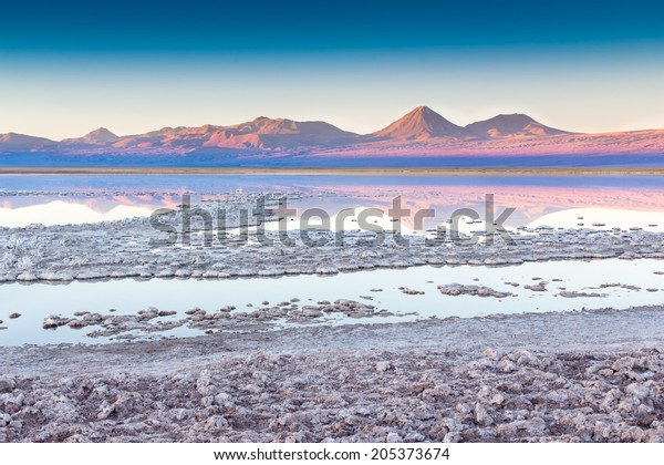 View of mountains reflected in a salt lake near San pedro de Atacama, Chile