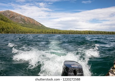 view of the mountains and the river from a motorboat
