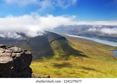 View of mountains and seashore in sunny day  from Slættaratindur  the highest point in the Faroe Islands, Denmark