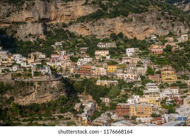 View of the mountainside surrounded by beautiful Positano buildings in Italy