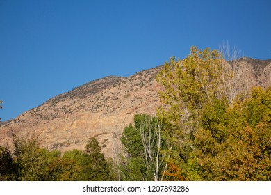 View of a mountainside in Utah on a clear autumn day