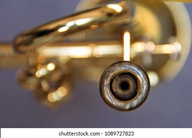 View of mouthpiece of a blurred trumpet