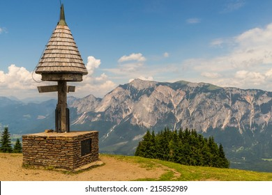 View from Mt. Dreilaendereck at the border of Austria, Italy and Slovenia with it's old monument to the impressive Mt. Dobratsch