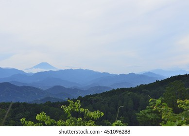 View of Mt. Fuji and mountain layers from Mt. Takao.