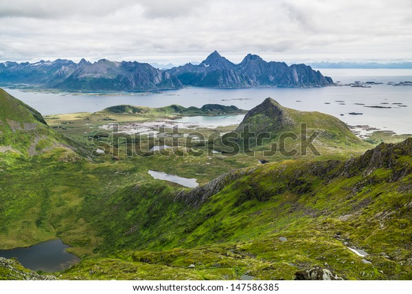 View from mt. Hellostinden to Henningsvaer and mt. Vaagakallen, Lofoten Norway