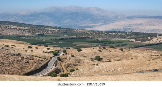 a view of mt hermon in the golan heights from near the lebanon border with an israeli farm in the foreground