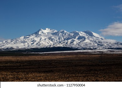 A view of Mt Ruapehu volcano in the Tongariro National Park covered in snow during winter. Central plateau of the North Island of New Zealand.