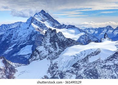 View from Mt. Titlis in the Swiss Alps. Titlis (also Mount Titlis) is a mountain of the Uri Alps, located on the border between the Swiss cantons of Obwalden and Bern.
