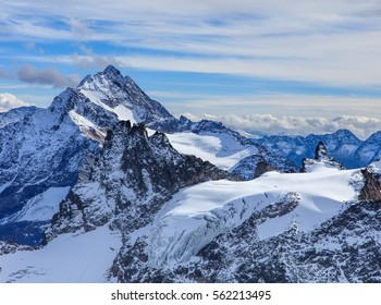 View from Mt. Titlis in the Swiss Alps in wintertime. Mount Titlis is a mountain of the Uri Alps, located on the border between the Swiss cantons of Obwalden and Bern.