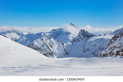 View from Mt. Titlis in Switzerland in winter. The Titlis is a mountain, located on the border between the Swiss cantons of Obwalden and Bern, it is usually accessed from the town of Engelberg.