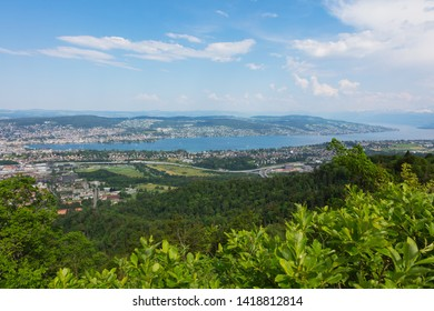View from from Mt. Uetliberg in Switzerland in summer. The Uetliberg is a mountain rising to 870 m and offering a panoramic view of the entire city of Zurich and Lake Zurich.