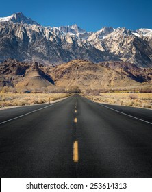 View of Mt Whitney with a straight empty road