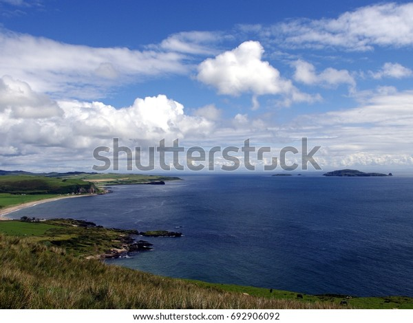 View Mull of Kintyre looking over Southend village to the Isle of Sanda with Ailsa Craig in the distance.