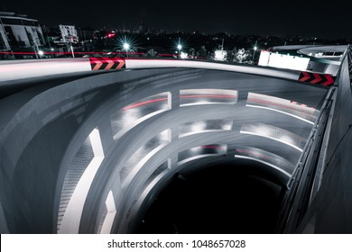 View of multilevel Parking lot, Circular ramp in parking garage at night