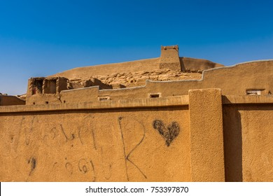 A view of the Munikh Castle wall and watchtower from the suburbs, Al Majmaah, Saudi Arabia